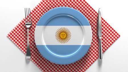 çeşniler : National cuisine and dishes of Argentina. Delicious recipes from Europe. Flag on a plate with food from Argentina. Stok Video