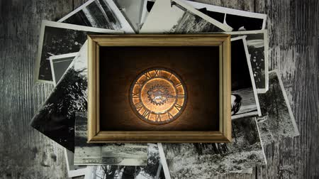 Antique clock in a frame on the wall. Old ancient clock. Mystical portrait. Stok Video