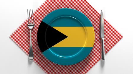 společenství : National cuisine and dishes of Bahamas. Delicious recipes. Flag on a plate with food from Bahamas. Commonwealth of the Bahamas.