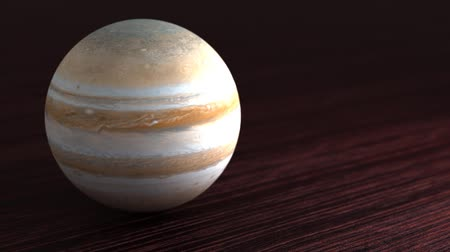 Planet of the solar system Jupiter. Little planet lies on the table. Stok Video