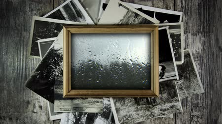 sepya : Photo frame with memories. Sad memory of the past. Rainy weather outside the window. Stok Video