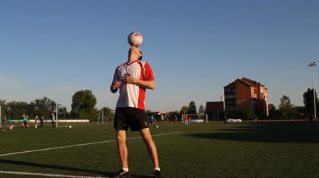 striker : Player is balancing a ball on his nose