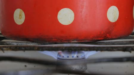 gas hob : The gas burner burns in an old dirty gas stove Stock Footage