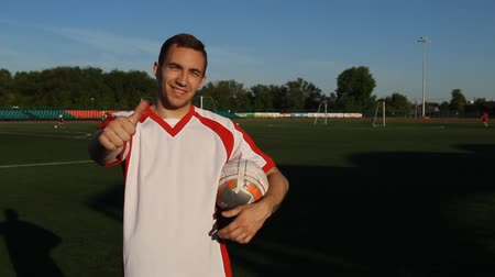 striker : Soccer player is giving a big thumbs-up, showing a like