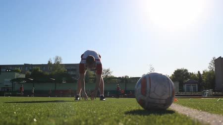 striker : Footballer flexing his muscles during the session Stock Footage