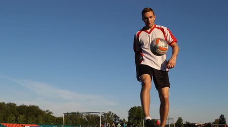 striker : Player kicks the ball by his feet during the session, view from below Stock Footage
