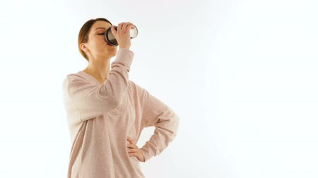 coffe : Young girl drinks from a cup of coffee, isolated