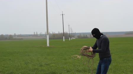 voltů : A man with a rope in a mask, theft, wires, electricity