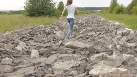 Girl jumping on rocks in nature Stok Video