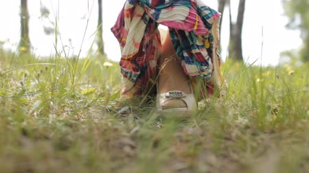 Girl takes off skirt in nature, close-up, grass Stok Video