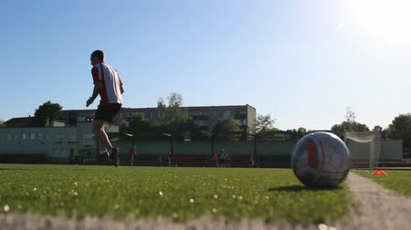 striker : Footballer is running and jumping during the training Stock Footage