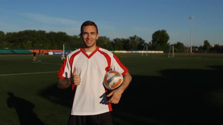 striker : Soccer player is showing a like, giving thumbs up Stock Footage