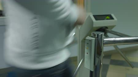ticket machine : Men pass the electronic turnstile with plastic card at the office Stock Footage