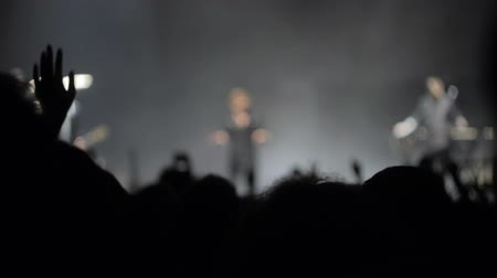 blurring : The singer is performing on stage, people are waving their hands, blurring Stock Footage