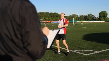 striker : Head coach looking at player Stock Footage