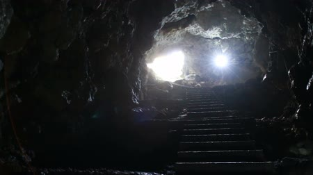 speleology : stairs and exit from the underground cave Stock Footage