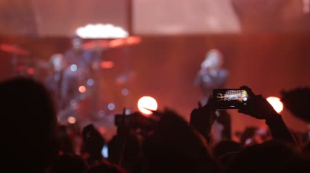 talk show : A man at the concert takes pictures of the singer