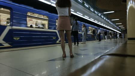 mind the gap : MINSK, BELARUS - JUNE 14, 2018: metro of Minsk, Grushevka station, undefined people are waiting for the arrival of the train and tnen board the train and departure