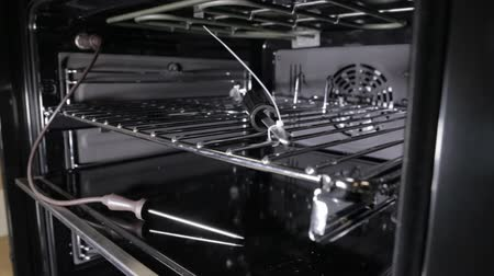 cooktop : Black stylish and modern gas stove with convection, close-up, view inside, grill Stock Footage