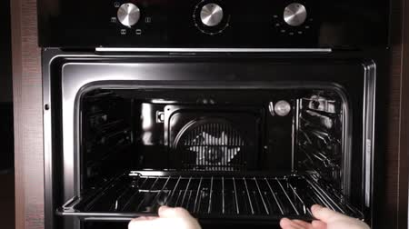 presented : Black stylish and modern gas stove with convection, close-up, domestic Stock Footage