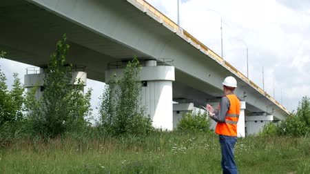 bridgework : Inspector writes to the folder and checks the status of the bridge across the river, engineering