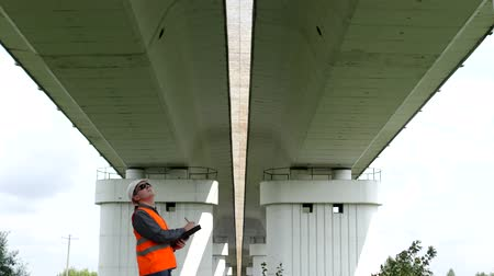 bridgework : Inspector engineer checks the condition of the motor bridge over the river