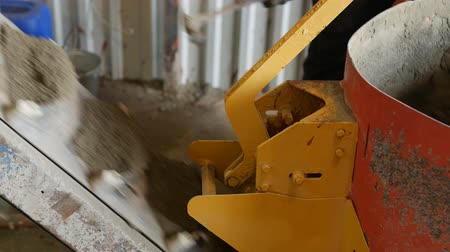 puncs : Concrete mixer preparate mixture for manufacturing of segmental pavers. Not an automated job