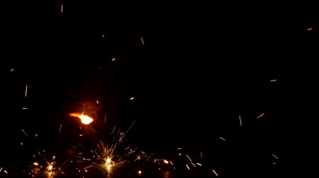 titular : Welder welds a metal part, a lot of sparks and smoke, close-up, welding, close-up, construction