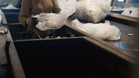 harmful : Women by hands sorting garbage in the form of polyethylene for further waste recycling Stock Footage