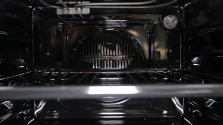 presented : Black stylish and modern gas stove with convection, close-up, view inside, grill Stock Footage