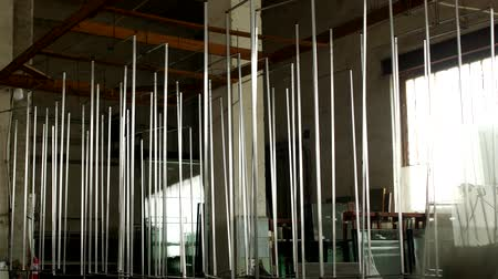 pvc frames : The shop for the production and manufacture of PVC windows, metal frames hang in the workshop for further assembly of the glass unit and PVC windows, workshop Stock Footage