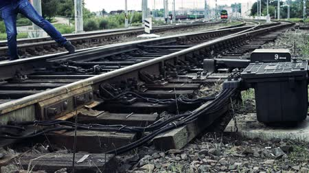szabály : man fools with railroad switch and risks his life on the railway, life threatening Stock mozgókép