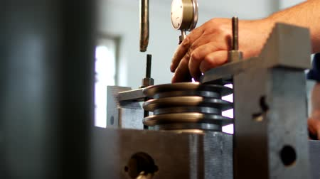 repairer : The male specialist measures the size of the tolerance device and the value in the metal pulley for manufacturing, close-up, measuring Stock Footage