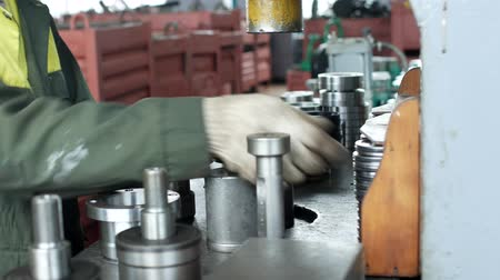 franzir : The worker at the plant presses the bearing into the hub using a press machine, assembling the hub, assembling the unit for mechanical engineering, close-up, ferreous Stock Footage
