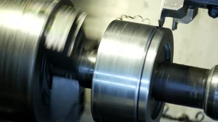 clamp : CNC lathe pulls out part of metal workpiece pulley, modern lathe for metal processing, close-up, metalwork