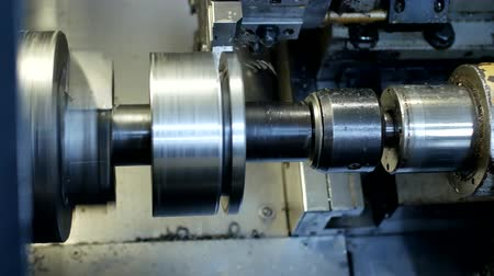 clamp : CNC lathe pulls out part of metal workpiece pulley, modern lathe for metal processing, close-up