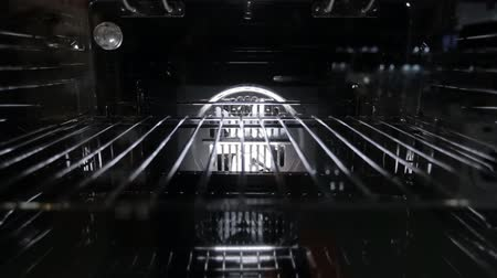 gas burner flame : Black stylish and modern gas stove with convection, close-up, view inside, grill Stock Footage