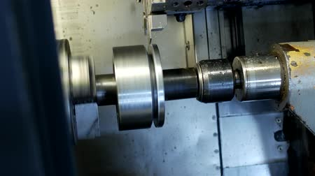 work hard : CNC lathe pulls out part of metal workpiece pulley, modern lathe for metal processing, close-up, metal Stock Footage