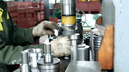 franzir : The worker at the plant presses the bearing into the hub using a press machine, assembling the hub, assembling the unit for mechanical engineering, close-up, pillow Stock Footage