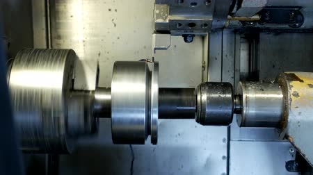 clamp : CNC lathe pulls out part of metal workpiece pulley, modern lathe for metal processing, close-up, machinery Stock Footage