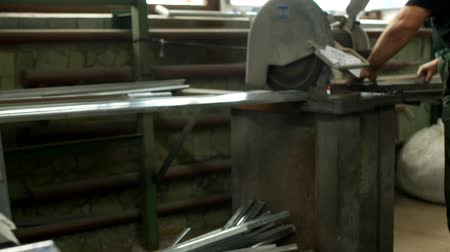 pvc frames : The worker cuts a metal profile for a pvc window on a circular saw, circular saw and metallic profile Stock Footage
