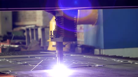 laser engraving : Plasma cutting of metal on an automatic laser machine, laser plasma cutting machine for cutting parts from metal, production