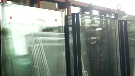 double glazed windows : The shop for the production and manufacture of PVC windows, ready-made double-glazed windows stand in the shop for further assembly of PVC windows, manufacturing Stock Footage