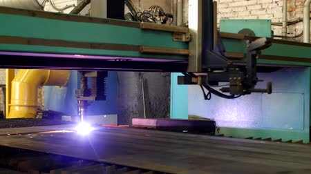 jiskry : Plasma cutting of metal on an automatic laser machine, laser plasma cutting machine for cutting parts from metal, production, processing