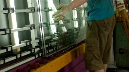 double glazed windows : The shop for the production of double-glazed windows and PVC windows, the worker collects a double-glazed window from the windows, for further assembly of the PVC window, close-up Stock Footage