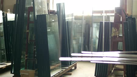 sealed : The shop for the production and manufacture of PVC windows, ready-made double-glazed windows stand in the shop for further assembly of PVC windows, insulating