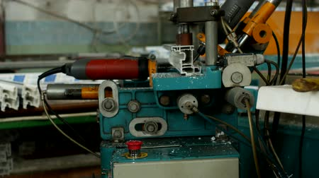double glazed windows : Production and manufacturing of pvc windows, male worker drills holes on a drilling machine in a pvc profile for manufacturing a pvc window, close-up, industrial Stock Footage