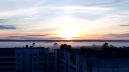 cockcrow : Early morning, sunrise in thick fog, residential area of the city, outskirts of the city, timelapse, morning dawn, morning