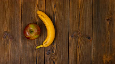 balanced : choice between healthy and harmful food or drink, beer or fruits banana and apple Stock Footage