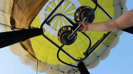 from air : Short bursts of hot air balloon burner to keep going up Stock Footage